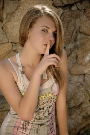 Teenage girl showing silence sign Stock Photo - 17366445