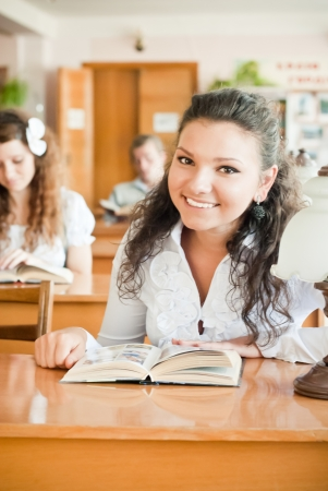 Happy student in library Stock Photo - 14335039