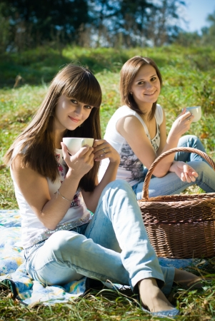 Two happy female friends on picnic Stock Photo - 17200087