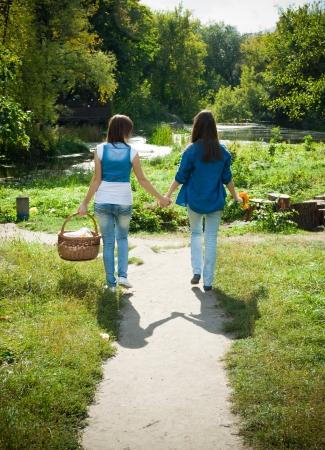 best friends: Two happy female friends walking