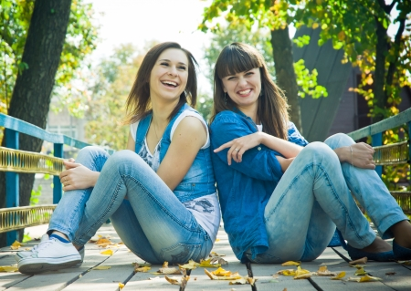 best friends: Girls laughing happilly