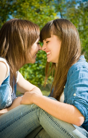 touching noses: Two happy girl friends