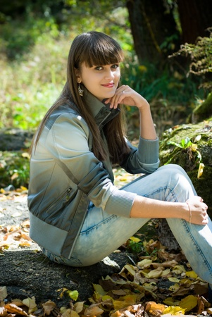 Portrait of young pretty woman outdoors photo