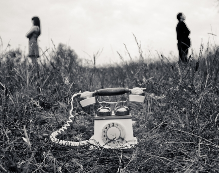 turn the dial: Retro phone and couple on background