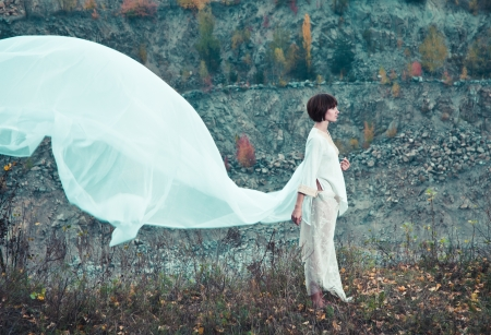 Woman in white flying fabrics photo