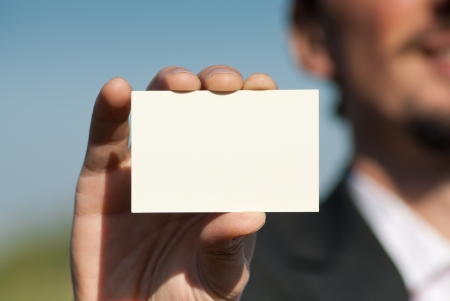 Man holding blank business card Stock Photo - 17374758