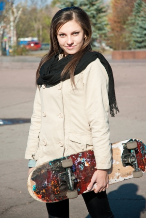 Young pretty woman with skate board photo