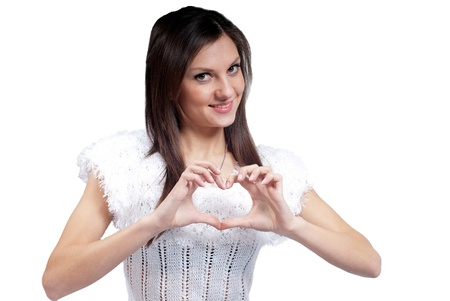 Young beautiful woman showing heart sign Stock Photo - 17369219