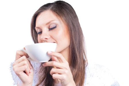 Young happy woman having cup of cappuccino Stock Photo - 17410549
