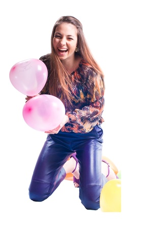 Beautiful young lady wearing leather trousers with balloons studio shot isolated photo