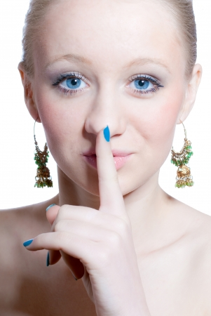 Young beautiful woman showing silence sign isolated over white Stock Photo - 17492642