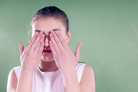 Young woman with eyes closed over greenscreen background Stock Photo - 17492666