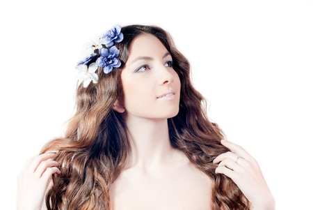 Young beautiful woman with long wavy hair and flowers Stock Photo - 17492709