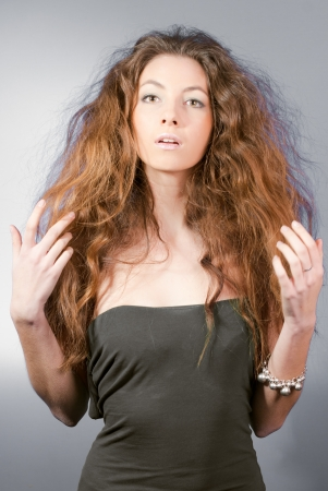 tousled: Young beautiful woman with long tumbled hair