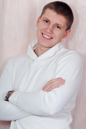 Handsome smiling happy young man studio portrait photo