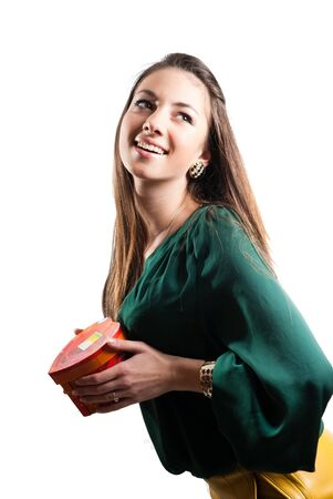Young happy woman holding gift box and smiling photo