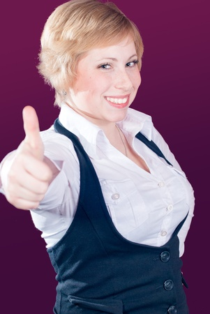 Young woman showing thumb up and smiling Stock Photo - 17547605