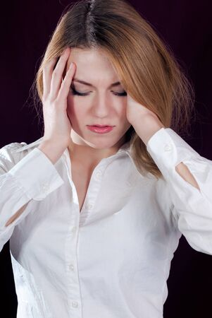 Young woman feeling headache Stock Photo - 17547610