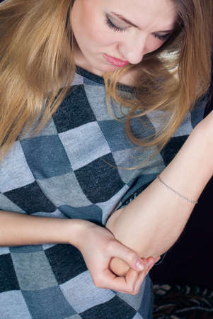 Young woman feeling pain in elbow Stock Photo - 17575561