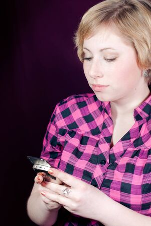 Young woman reading message on mobile phone photo
