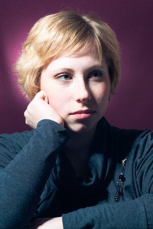 Young serious woman studio portrait photo