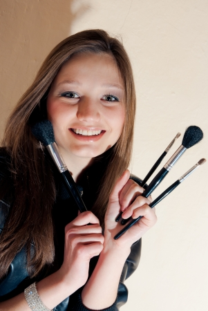 Beautiful woman with set of makeup brushes photo