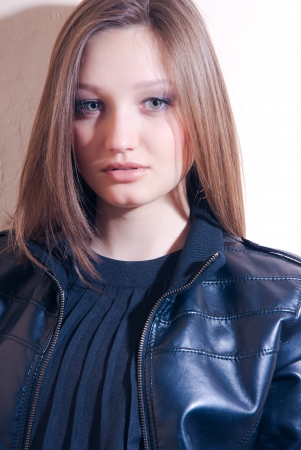 Beautiful fashion girl in leather jacket photo
