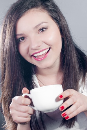 Young happy woman with white cup Stock Photo - 17577099
