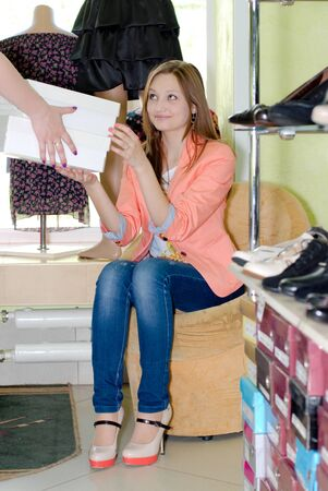 Young beautiful woman in shoe shop photo
