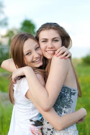 Two happy teenage friends having fun Standard-Bild