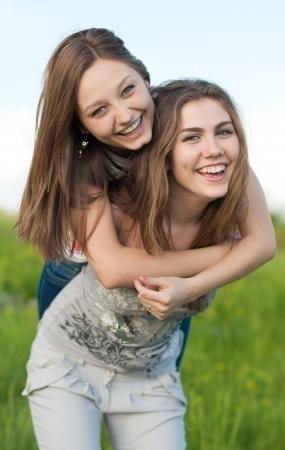 beautiful teen girl: Two happy teenage friends having fun Stock Photo