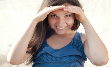 Happy young woman looking under hands Stock Photo - 17630272