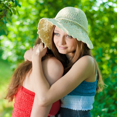 Young woman comforting her crying friend Stock Photo
