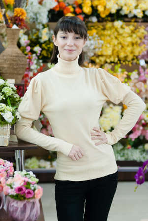 Young beautiful happy smiling female lady woman working in flower shop photo
