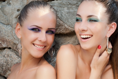 naked youth: Two young beautiful happy laughing fashion models with bright makeup
