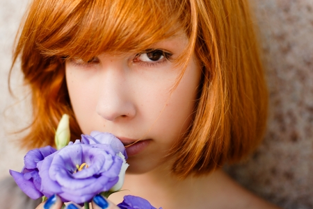 Young beautiful happy redhead teenage woman model girl holding purple chinese rose photo
