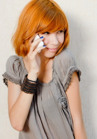 Young beautiful woman talking on mobile phone and smiling photo