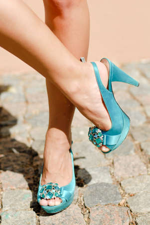 velure: Beautiful legs in blue high heel shoes