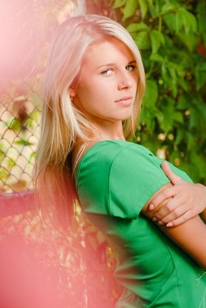 beautifull woman: Young beautiful woman portrait among green leaves of virginia creeper Stock Photo