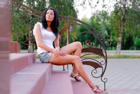 beautifull woman: Young happy beautiful woman model sitting on stairs outdoors Stock Photo
