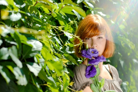 Beautiful redhead teenage girl woman with purple rose by green leaves background Stock Photo - 18024766