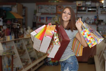 Happy young woman with shopping bags Stock Photo - 18034860