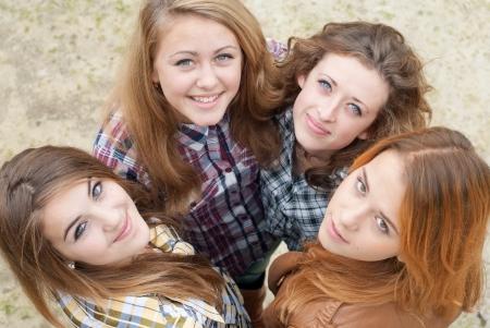 beautifull woman: Four happy teen girls friends