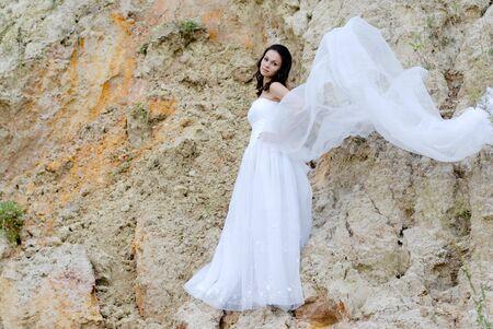 beautifull woman: Young beautiful bride among sands thoughtful Stock Photo