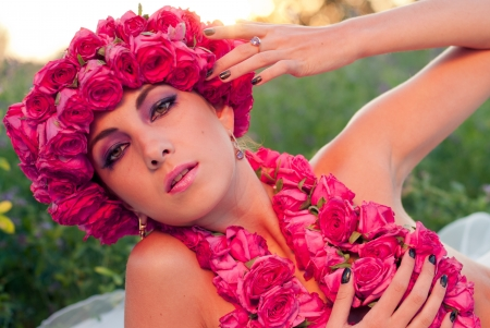 Young beautiful model with rose crown photo