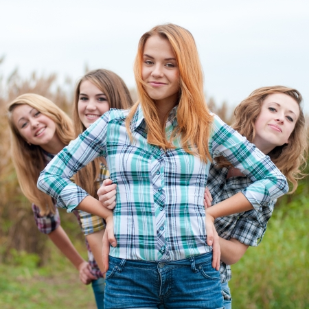 beautiful long hair: Four happy teenage girls friends Stock Photo