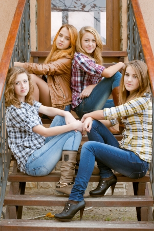 Four happy teen girls friends photo