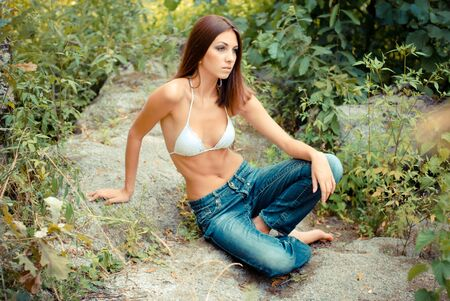 beautifull woman: Young beautiful woman standing on her knees