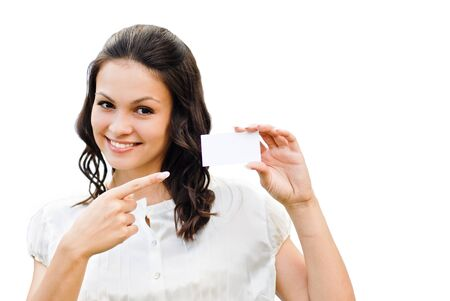 Young beautiful woman holding  business card with copy space isolated over white background photo
