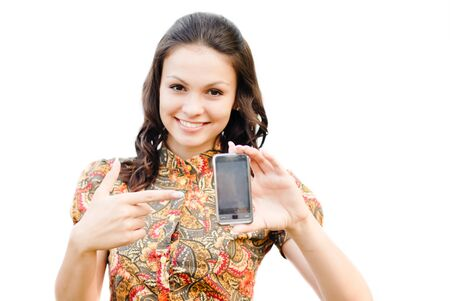 Young beautiful woman holding  touch phone with copy space isolated over white photo